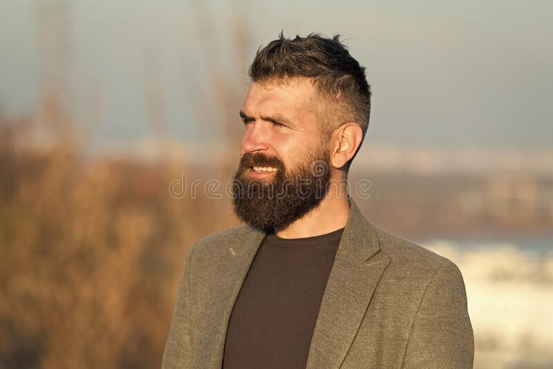 Barber hairdresser salon. Guy stylish long beard. Fresh haircut. Man bearded hipster with mustache blue sky background stock photos