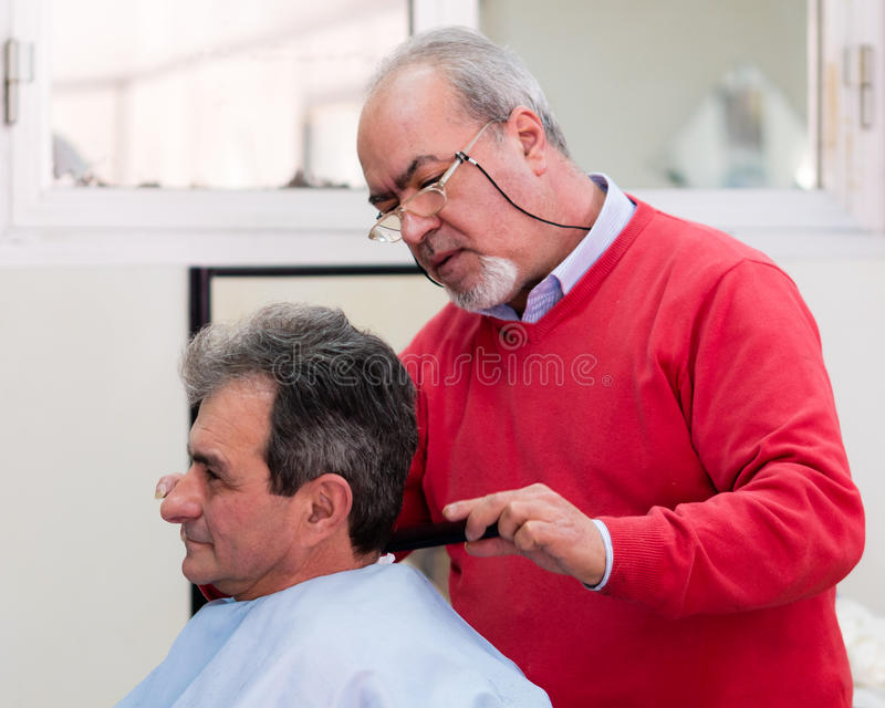 Barber Hairdresser. Skilled old Barber Hairdresser in Italy Sicily stock photos