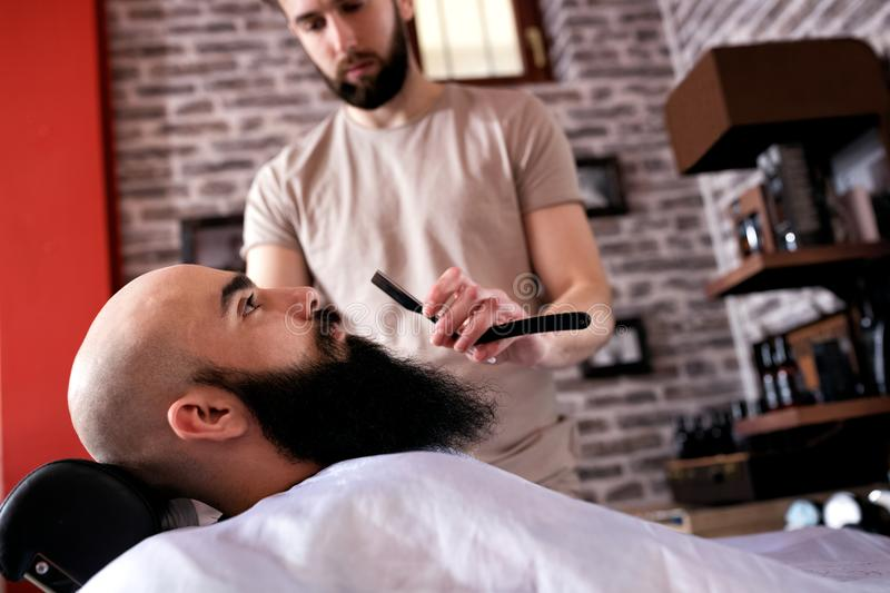 Barber with old-fashioned black razor royalty free stock photo