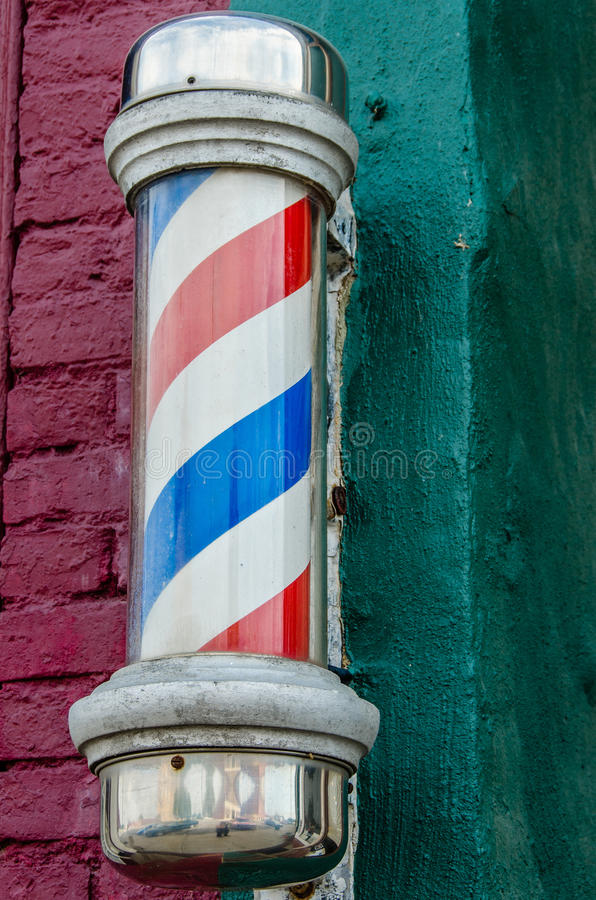 Barber Pole. Historic barber pole in a small town business. Pole is an antique stock image