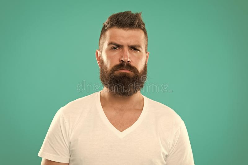 Barber salon. Beard fashion and barber concept. Man bearded hipster stylish beard turquoise background. Barber tips. Maintain beard. Stylish beard and mustache royalty free stock photography