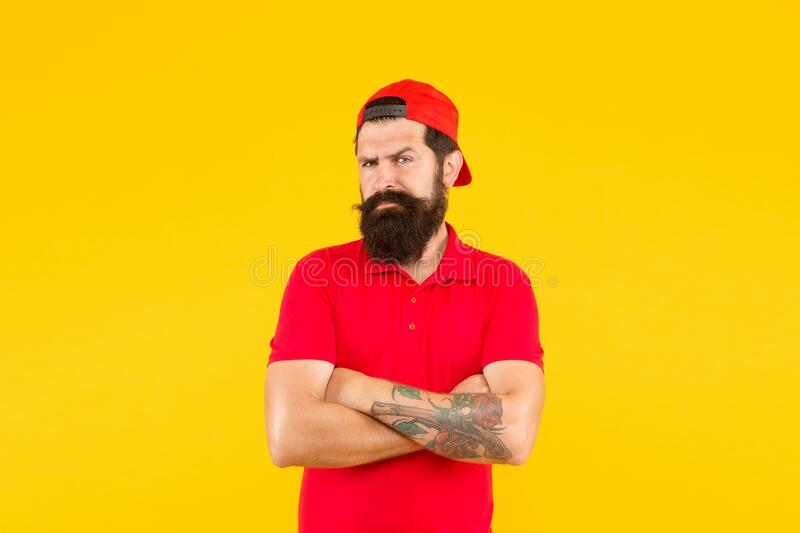 Barber salon and facial hair care. Masculinity. Hipster life. Brutal handsome hipster tattooed man. Bearded man trendy. Style. Beard and mustache grooming. Cool stock photography
