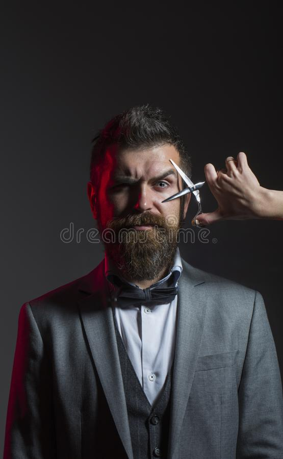 Barber scissors. Mens haircut. Bearded man, long beard, brutal, caucasian hipster with moustache, haircut. Handsome stock images
