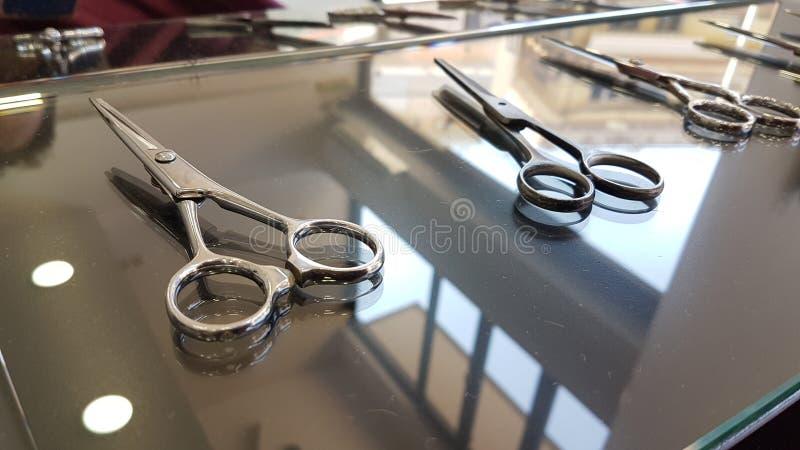 Barber scissors set barbershop accessories. Equipment stock images
