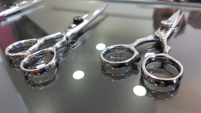 Barber scissors set barbershop accessories. Equipment royalty free stock photos
