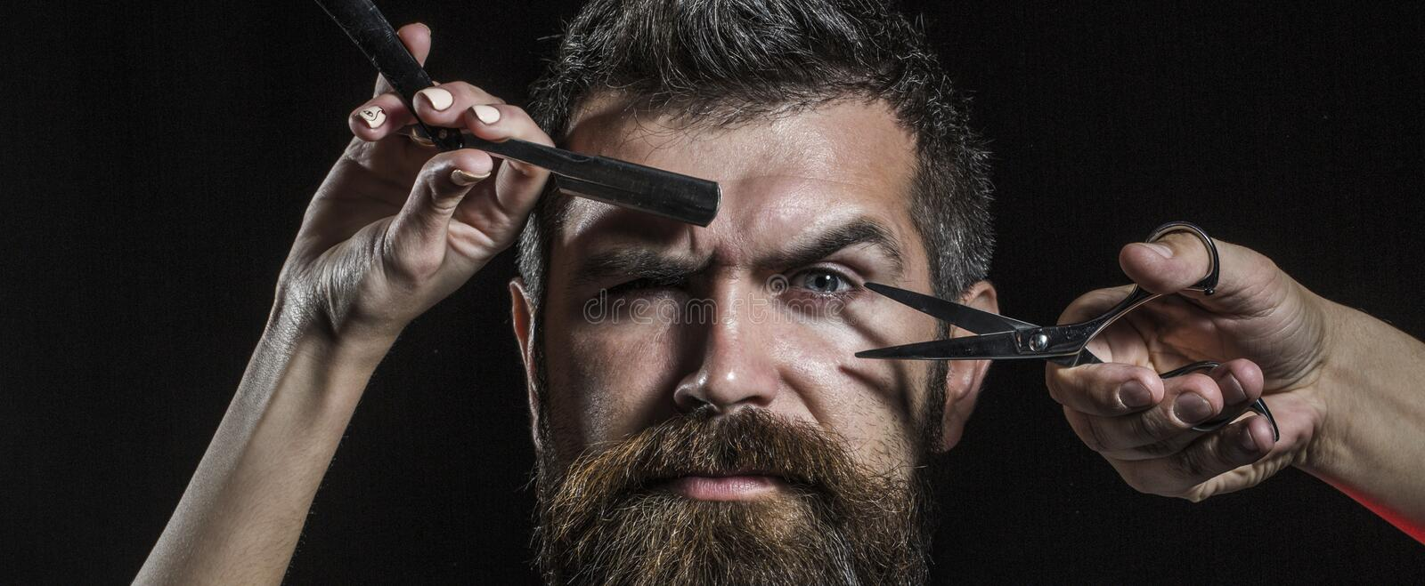 Barber scissors and straight razor, barbershop. Mens haircut, shaving. Bearded man, long beard, brutal, caucasian royalty free stock image