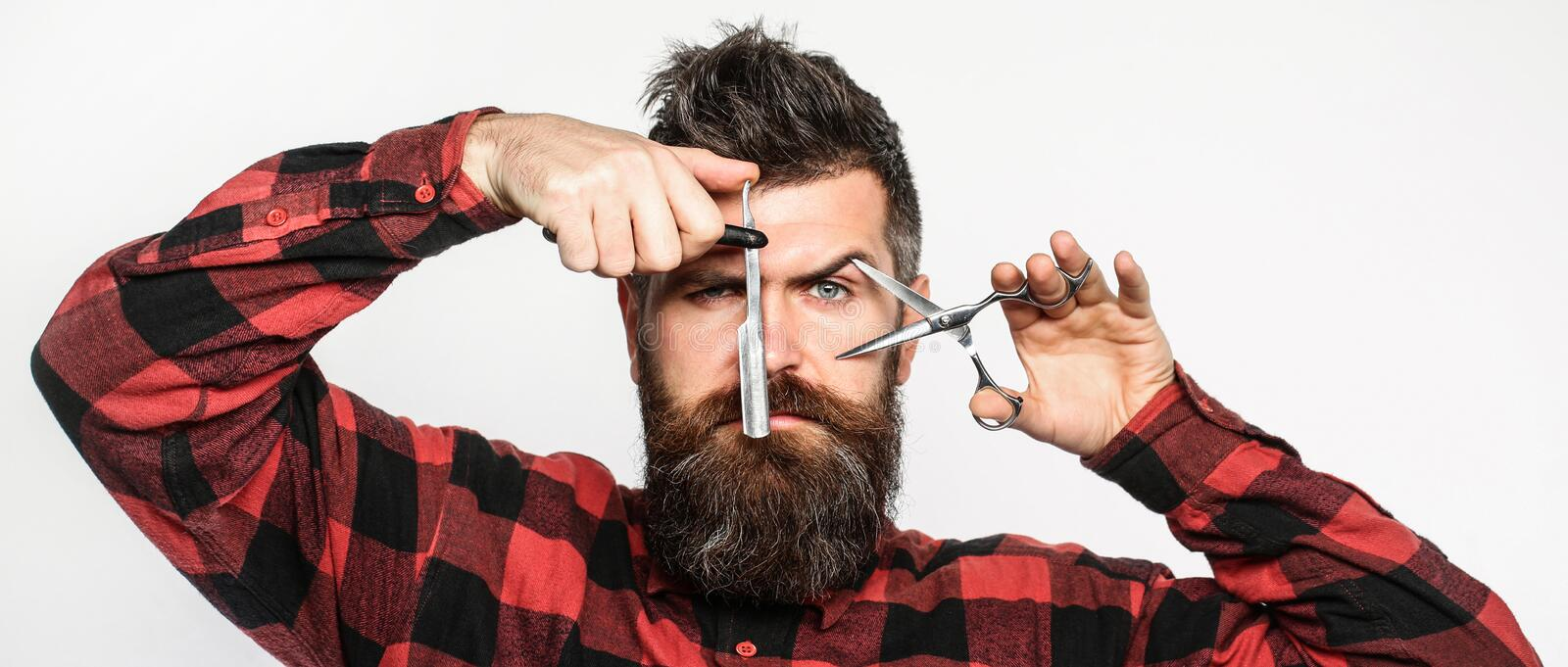 Barber scissors and straight razor, barbershop. Mens haircut, shaving. Bearded man, long beard, brutal, caucasian royalty free stock photo