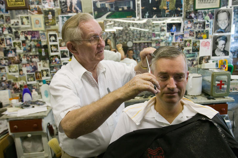 Barber Shop. Floyd cutting hair at Floyd's City Barber Shop in Mount Airy, North Carolina, the town featured in �Mayberry RFD� and home of Andy royalty free stock photos