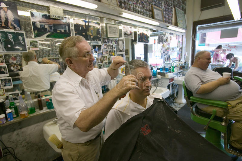 Barber Shop. Floyd cutting hair at Floyd's City Barber Shop in Mount Airy, North Carolina, the town featured in �Mayberry RFD� and home of Andy royalty free stock images