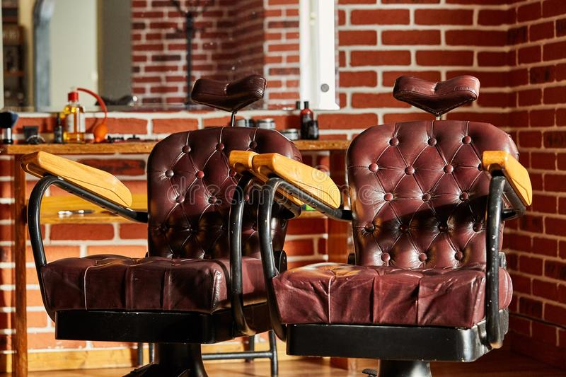 Retro leather chair barber shop in vintage style. Barbershop theme. stock photo