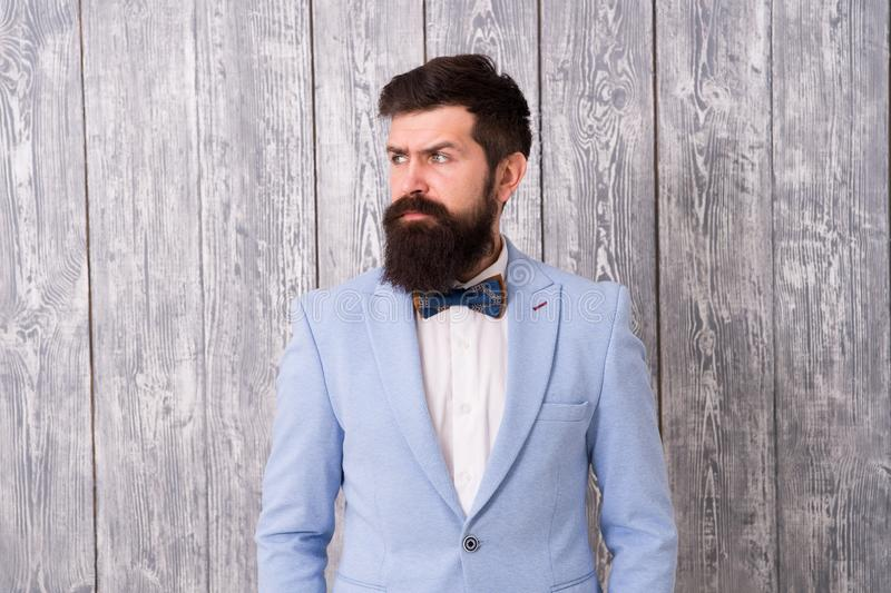 Barber shop offer range of packages for groom make his big day unforgettable. Guy well groomed bearded hipster wear. Tuxedo. Hairstyle and beard grooming royalty free stock photos
