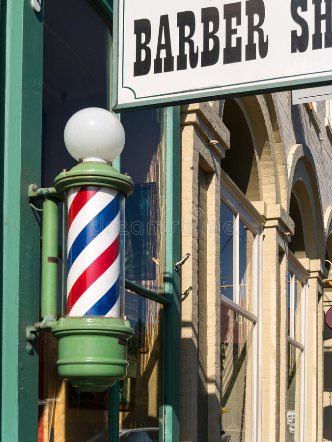 Barber Shop pole and sign stock images