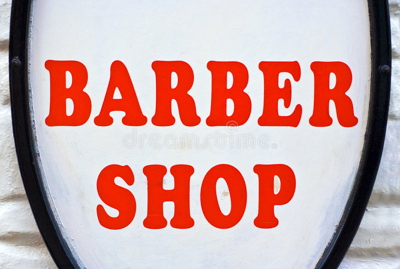 Barber Shop Sign. A Barber Shop sign with red letters and a white background stock photos