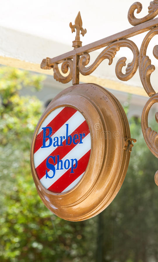 Barber shop sign. Hanging in front of a shop royalty free stock image