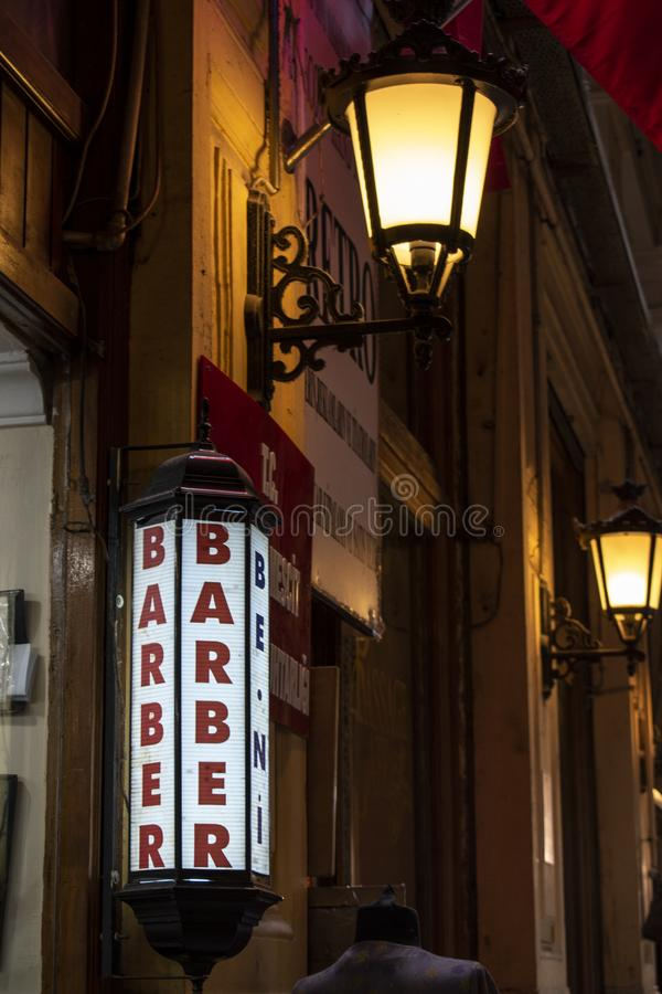 Barber, barber shop, sign, vintage, retro style, Istanbul, Turkey, Middle East, Cicek Pasaji, the Flower Passage. Istanbul, Turkey, Middle East: sign of a barber royalty free stock photos