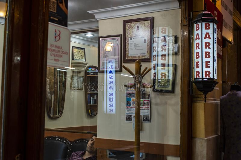 Barber, barber shop, sign, vintage, retro style, Istanbul, Turkey, Middle East, Cicek Pasaji, the Flower Passage. Istanbul, Turkey, Middle East: a Turkish man stock photography