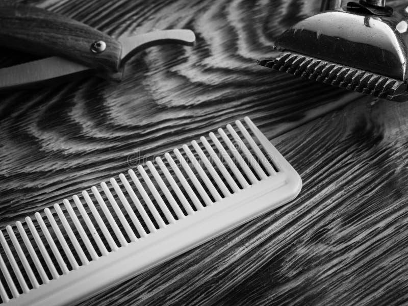 Barber shops tools on wooden desk. bw stock images