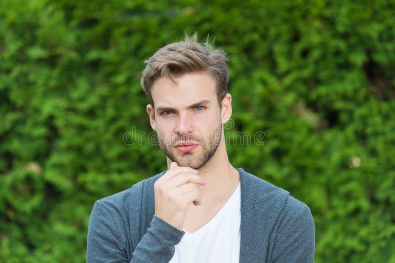 Barber superhero. spring male fashion. stylish unshaven man. Handsome caucasian man green background. Bearded guy casual stock photo