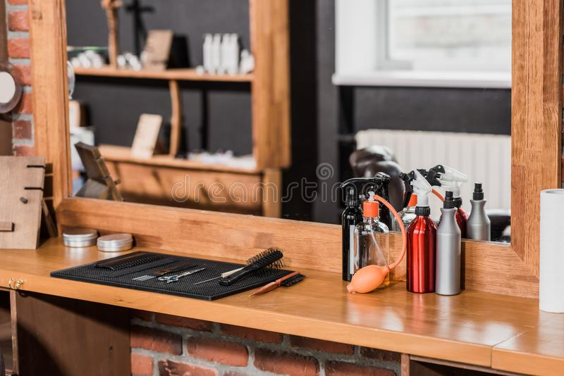 barber tools and spray bottles on counter royalty free stock photography