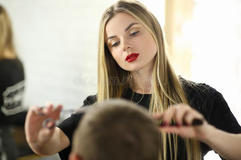 Barber Woman Cutting Male Hair in Barbershop Salon. Young Hairdresser Making Haircut to Client. Professional Beautician Styling Hairdo for Customer. Girl stock photos