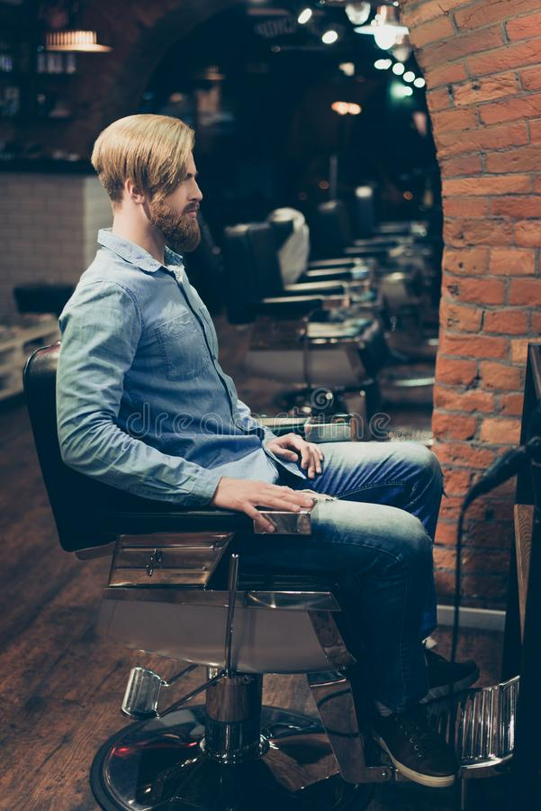 Barbershop concept. Full length portrait of red bearded harsh st royalty free stock image