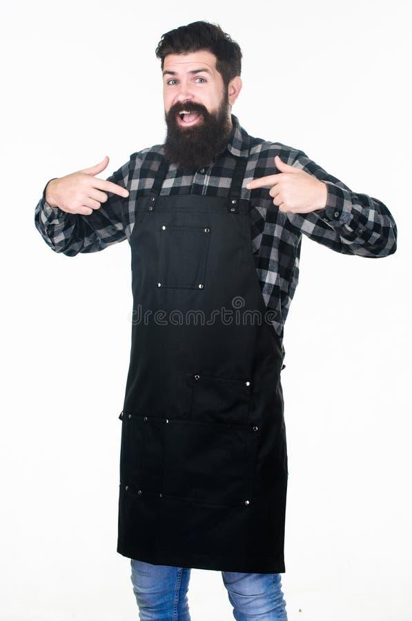 Barbershop concept. Hairdresser barber salon for men. Uniform for barber salon. Man brutal bearded hipster wear apron stock photos