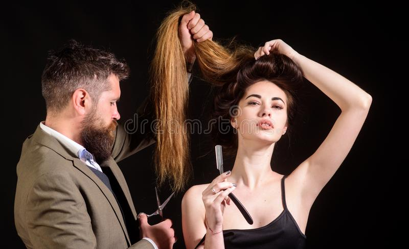 Barbershop hairdresser salon. Bearded male. hairdresser cutting clients hair with scissors at hair salon. woman with royalty free stock images