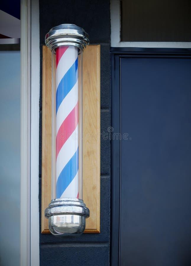 Barbershop hairdresser traditional sign red blue and white spinning pole. Barber shop pole vintage sign classic hairdresser stock images