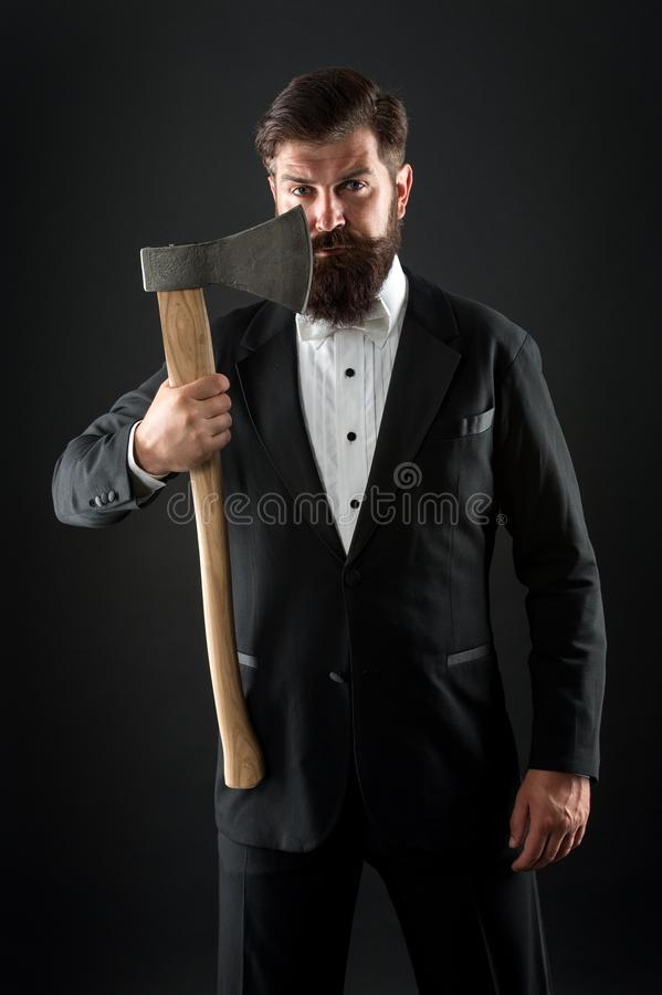 Barbershop hairstyle. Brutal barber. Brutal manners. Resoluteness concept. Own opinion. Decision was made. Man brutal. Hipster with axe. Sharp ax hand confident stock image