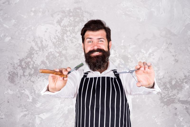 Barbershop master. Hairstyle concept. Grooming beard and mustache. Facial hair. Bearded barber shaving. Barber tools. Barber in apron hairdresser equipment royalty free stock image