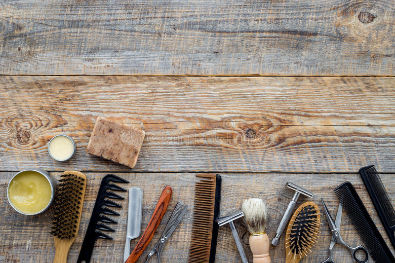 Barbershop. Men`s shaving and haircut. Brush, razor, comb, sciccors on wooden table background top view copyspace stock photography