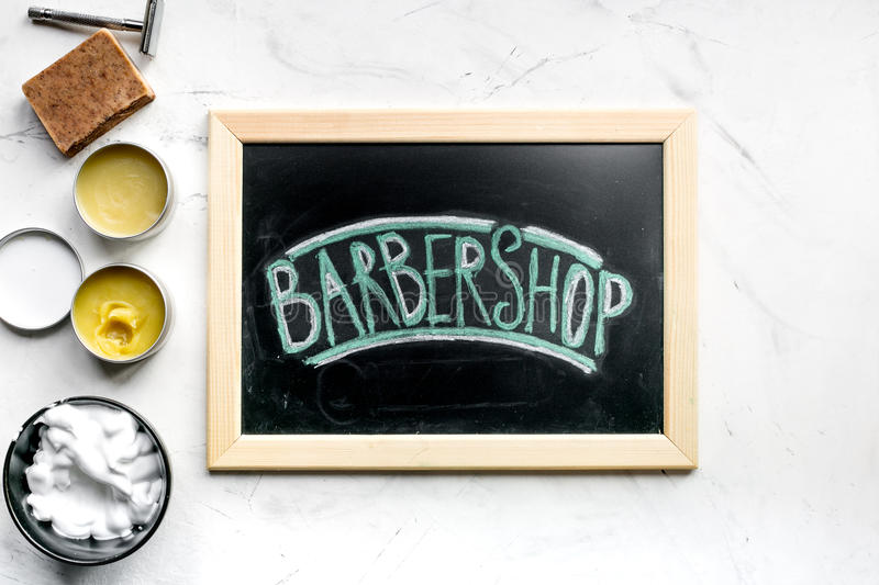 Barbershop sign in men cosmetic concept on white background top view. Barbershop sign in men cosmetic concept on white desk background top view royalty free stock images
