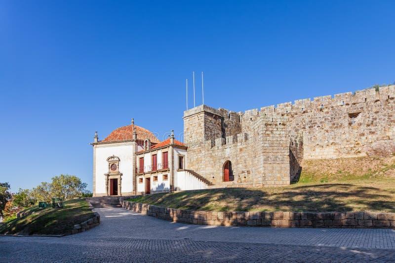 Barbican entrance of the Castelo da Feira Castle and Nossa Senhora da Esperanca Chapel. On the left. Santa Maria da Feira, Portugal royalty free stock photos