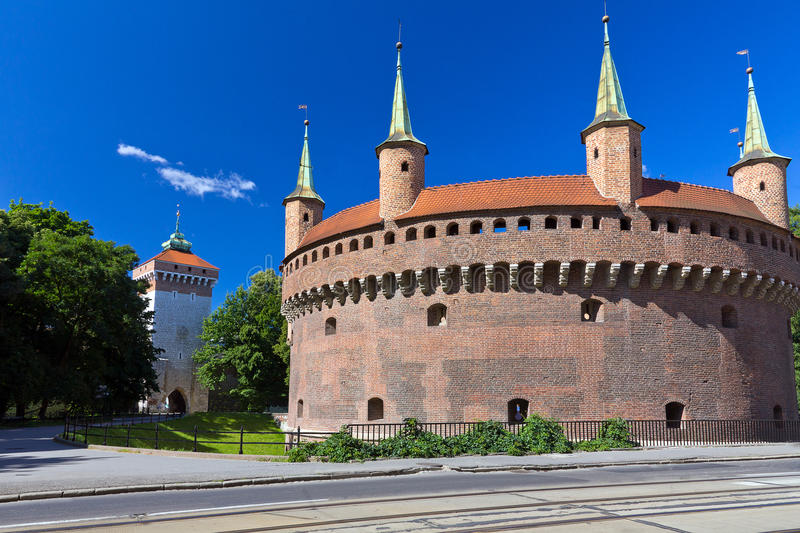 Barbican and St.Florian's Gate in Cracow - Poland. On a background of blue sky royalty free stock images