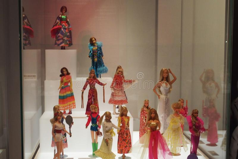 Barbie dolls dressed in different countries stock images
