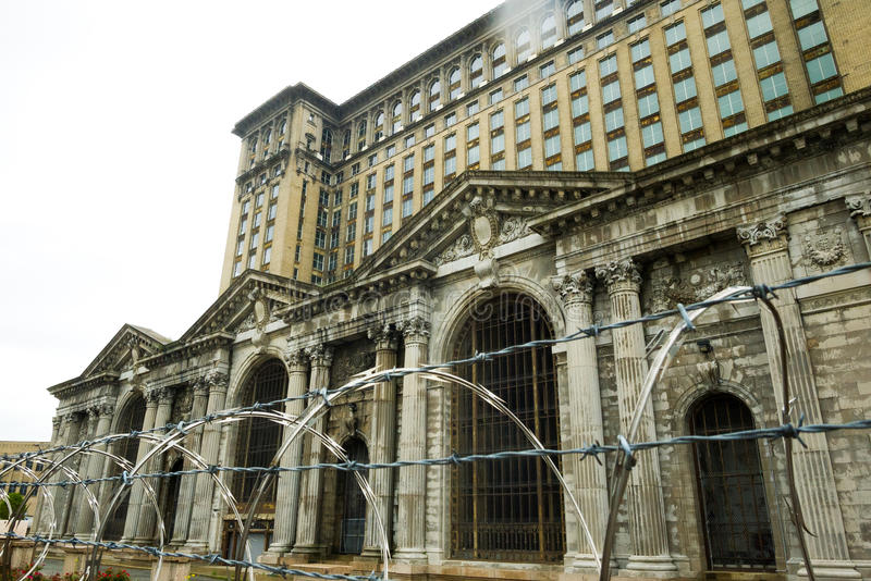 Barbwire fence and Michigan Central Station stock photo
