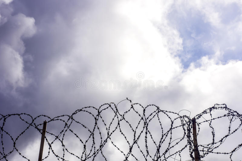 Barbwire On Sky Background. Stock Photos
