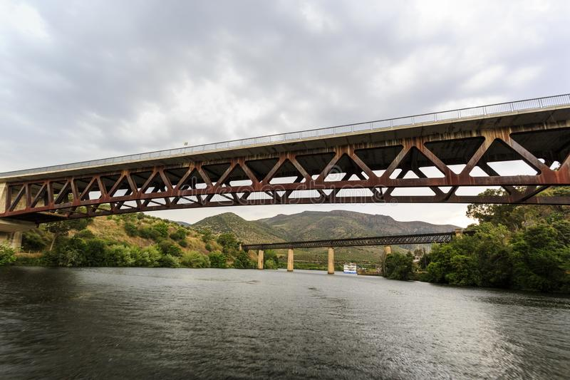 Barca de Alva – Two Bridges over Agueda River. The two bridges, railway and road, over the Agueda River, near the town of Barca de Alva between Portugal stock photo