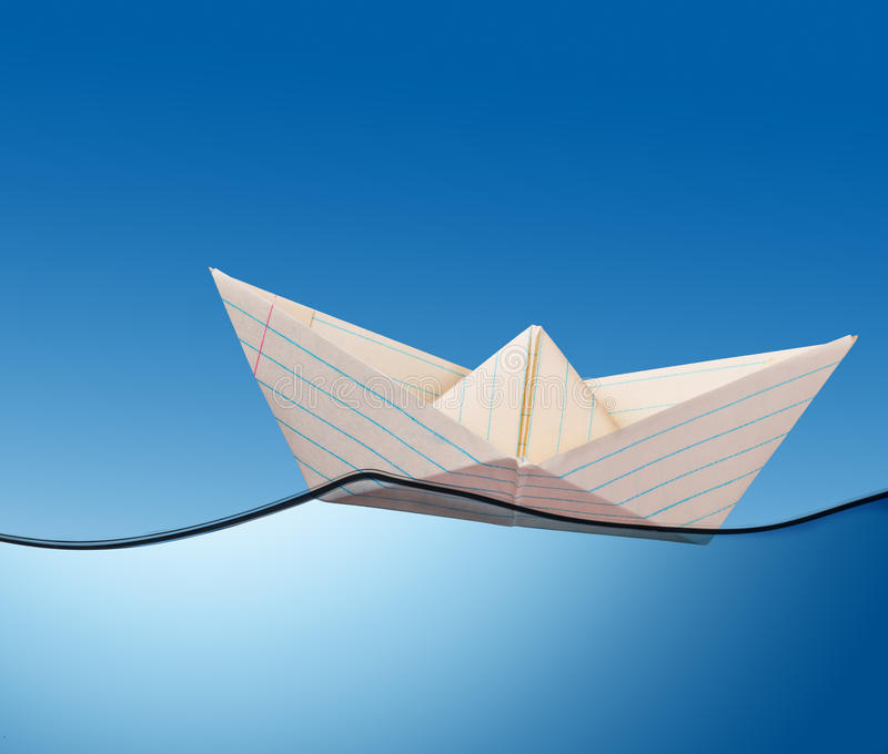 Barca di carta sull'oceano. illustrazione vettoriale