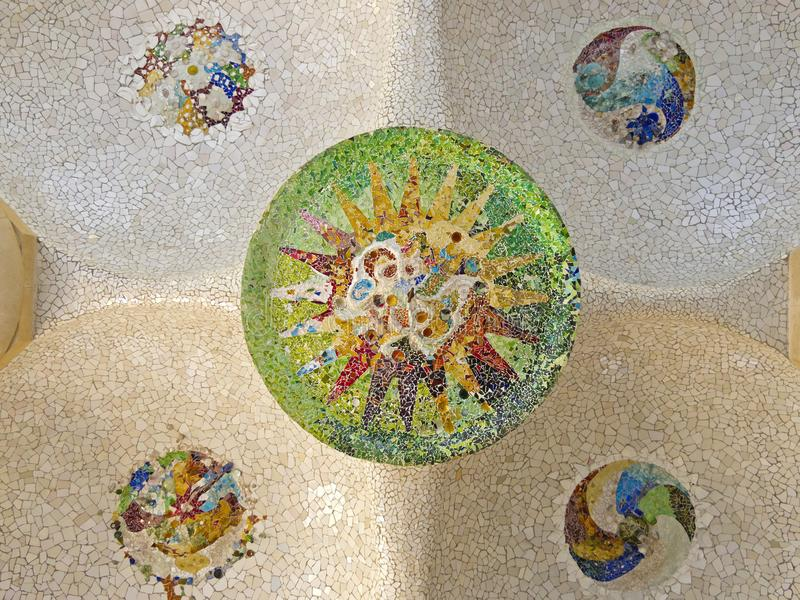 Ceiling with mosaic sun of Park Guell stock image
