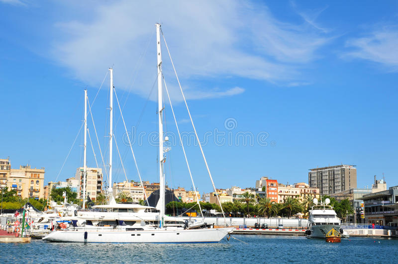 Barcelona. Spain - 6 July, 2012: City skyline seen from Port Vell, a waterfront harbour and major touristic attraction in , Catalonia royalty free stock photos