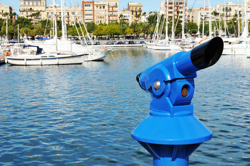 Barcelona. Touristic binocular overlooking Port Vell harbour in Barcelona, Spain stock image