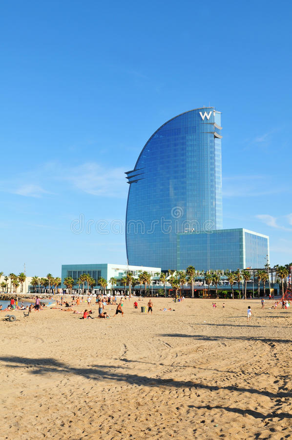 Barcelona. Spain - 6 July, 2012: The modern architecture of W Hotel overlooking the beach in Barceloneta district of  on a hot summer day royalty free stock image