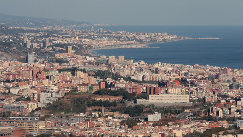 Barcelona and Badalona coast view. The city of Barcelona, dense residentials and office and commercial buildings along the coast from Barcelona to the nearby royalty free stock images