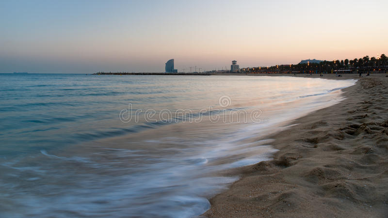 Barcelona beach. At sunset. Blurred motion royalty free stock photo