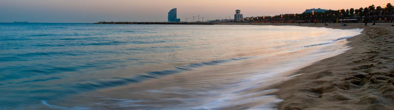 Barcelona beach. At sunset. Panorama royalty free stock image