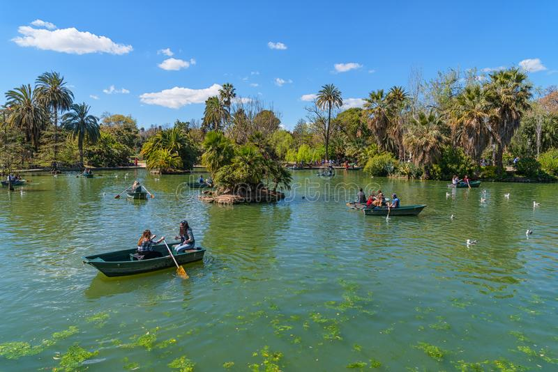 Parc de la Ciutadella in Barcelona, people rowing boats in the lake royalty free stock image
