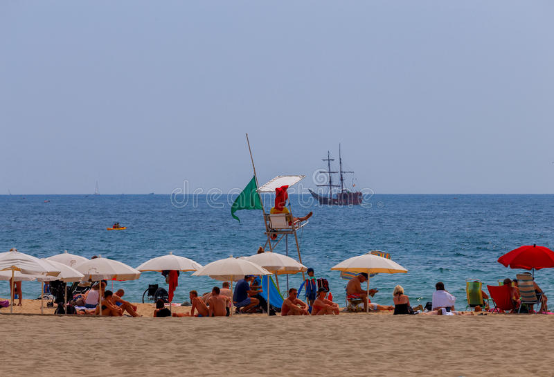 Barcelona. City Beach. Barcelona, Spain - July 15, 2017: People rest on a sandy beach in the area Pablenou. Barcelona. Spain stock images