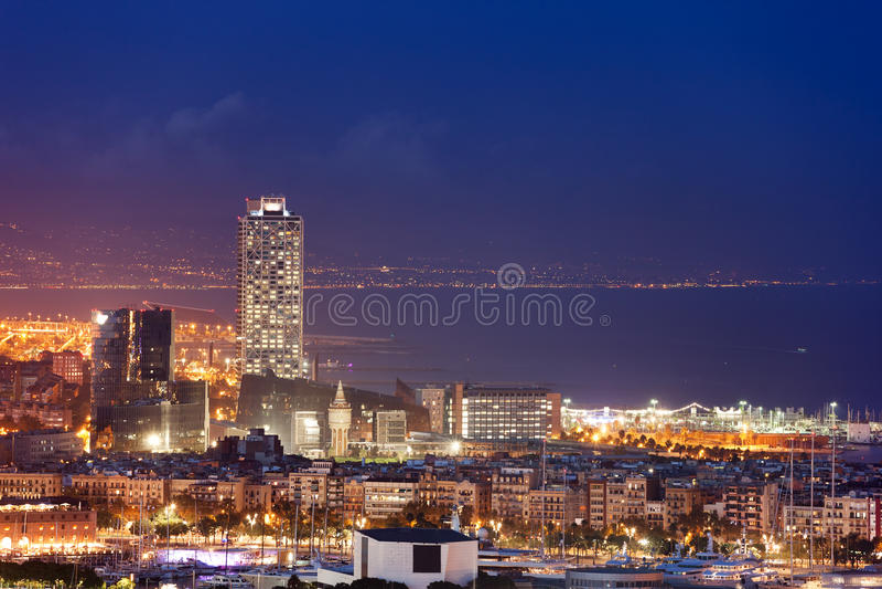 Barcelona City Skyline by Night. Spain, Barcelona city skyline at night by the Mediterranean Sea royalty free stock image