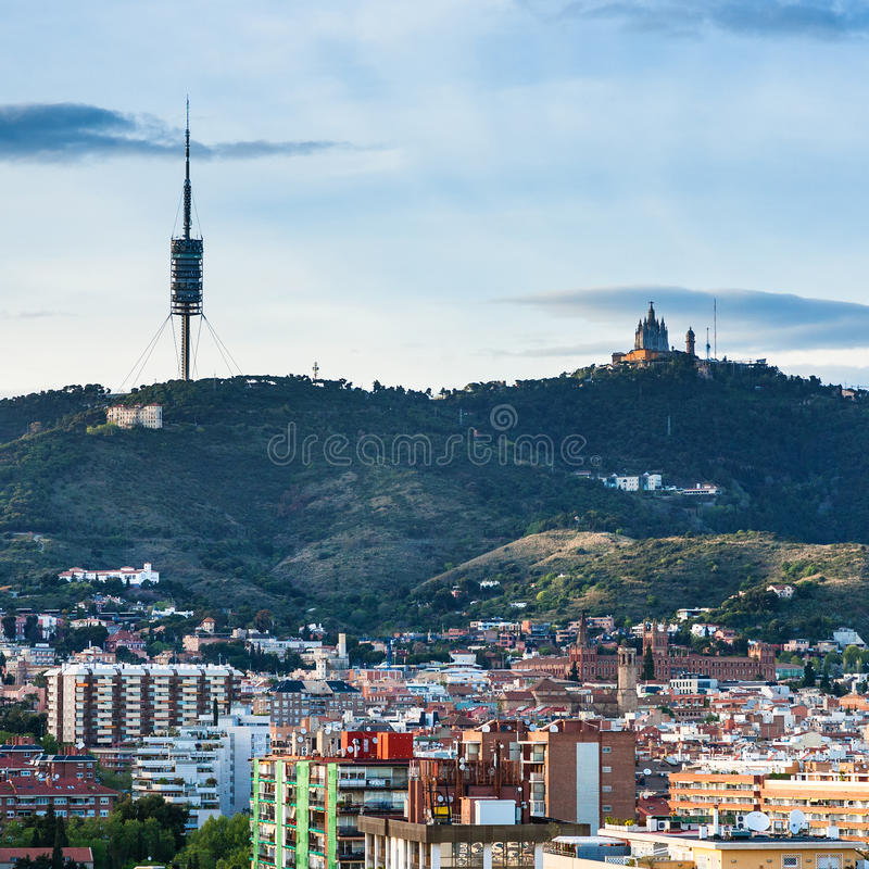 Barcelona city skyline with Tibidabo Mountain. In spring evening stock photography